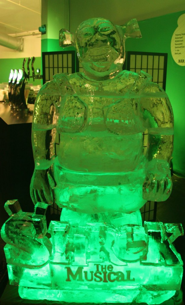 Shrek ice sculpture with green light
